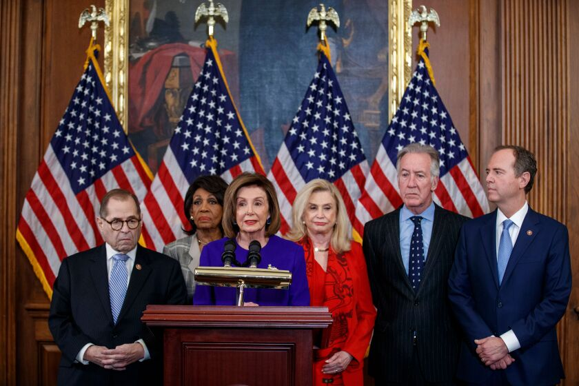 Speaker of the House Nancy Pelosi (D-San Francisco) and other members of Congress unveil articles of impeachment against President Trump on Tuesday.