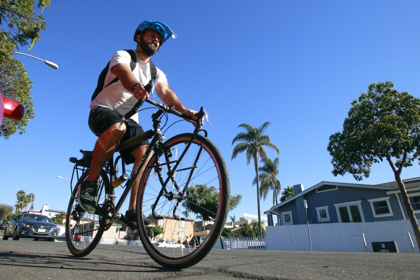 A cyclist rides west on Meade Avenue, where bike lanes are planned to be placed, in San Diego on Friday, Oct. 19, 2018.