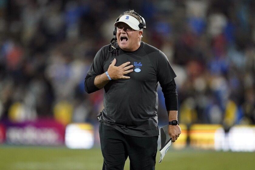 UCLA coach Chip Kelly yells instructions to one of his players from the sideline during a game against Fresno State
