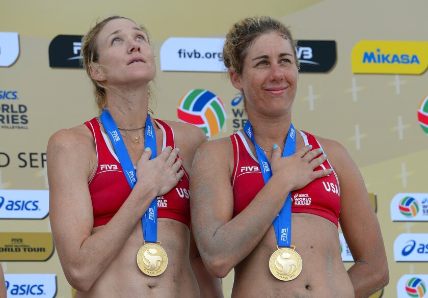 Kerry Walsh Jennings and April Ross stand on the podium after winning the gold medal at the FIVB Long Beach Grand Slam on July 27.