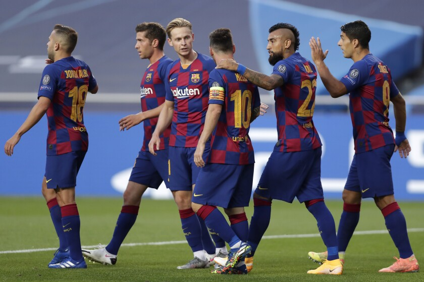 Players of Barcelona celebrate their first goal against Bayern Munich in the Champions League quarterfinals.