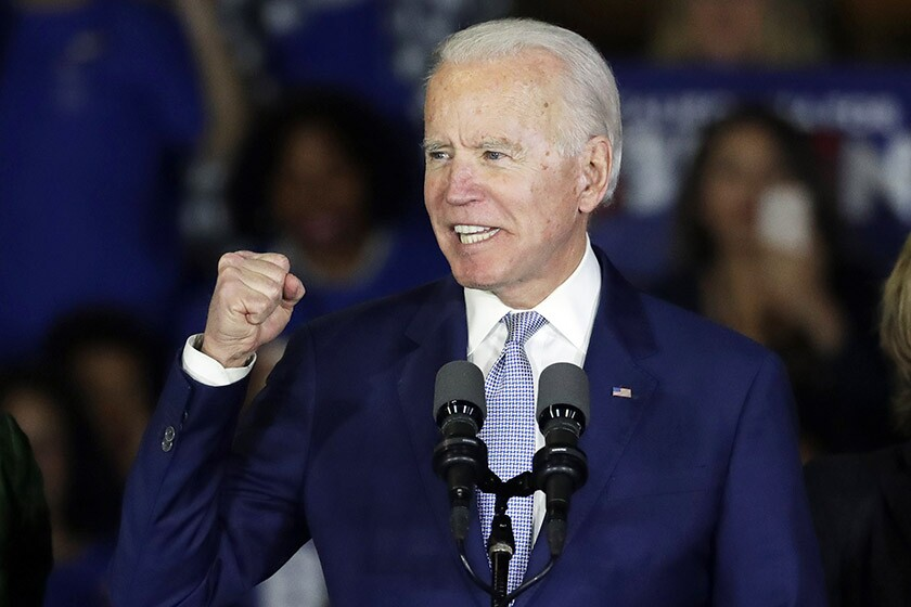 Democratic presidential hopeful Joe Biden takes the stage during a rally in Los Angeles.