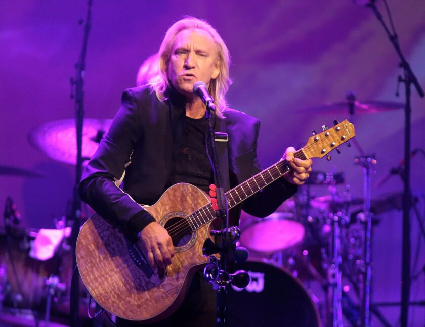 FILE - In this Oct. 12, 2015 file photo, Joe Walsh of the band The Eagles performs in a solo concert at The Fillmore in Philadelphia. Eagles keyboardist and guitarist Walsh says he's pulling out of a Cleveland summer concert he thought would be a nonpartisan event for veterans' families because it'