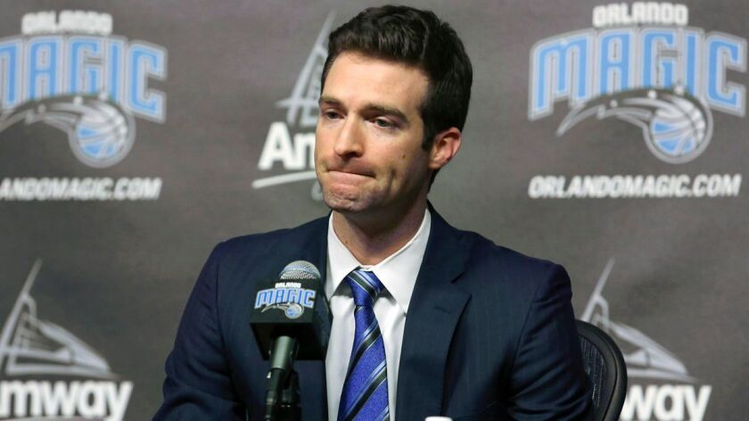 FILE - In this Feb. 5, 2015, file photo, Orlando Magic general manager Rob Hennigan pauses to answer