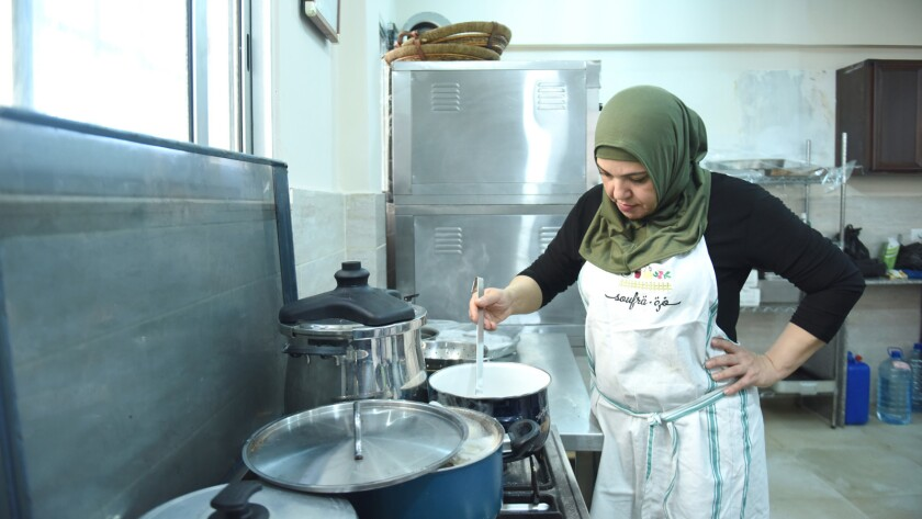 """Abeer Marsi in the kitchen from a scene in the movie """"Soufra."""" Credit: Vivien Best"""