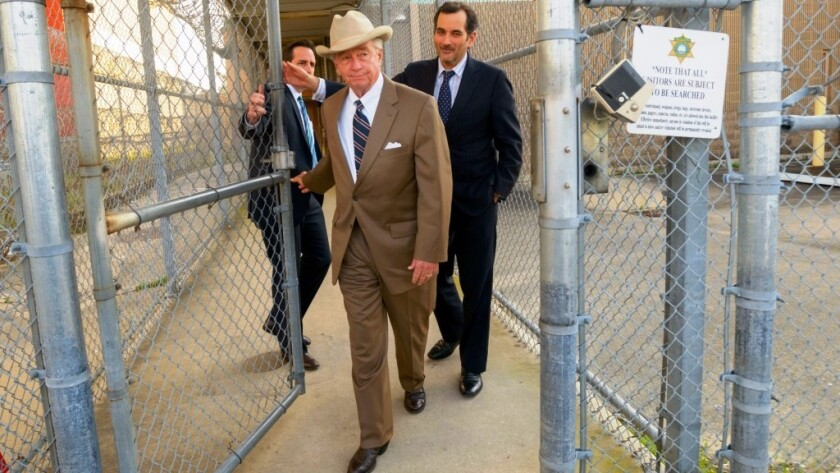 Texas attorney Dick DeGuerin, in cowboy hat,  won acquittal of Robert Durst in a previous murder case.