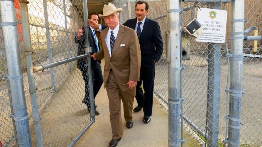 Texas attorney Dick DeGuerin, in cowboy hat, won acquittal of Robert Durst in a previous murder case.
