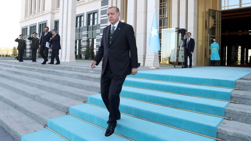 Turkish President Recep Tayyip Erdogan welcomes the Somalian president during an official welcoming