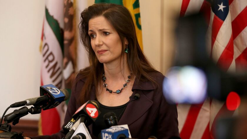 Oakland Mayor Libby Schaaf takes questions from the media during a press conference at City Hall in