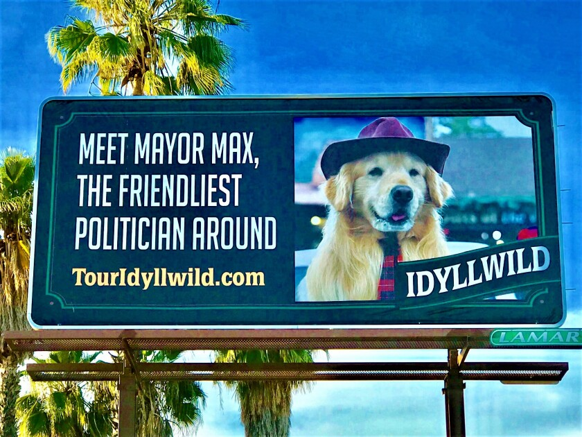 This billboard was erected along State Street in San Jacinto by Riverside County officials after wildfires, followed by heavy rains, damaged highways leading into the tiny mountain town of Idyllwild in which many residents depend upon tourism for their livelihood.