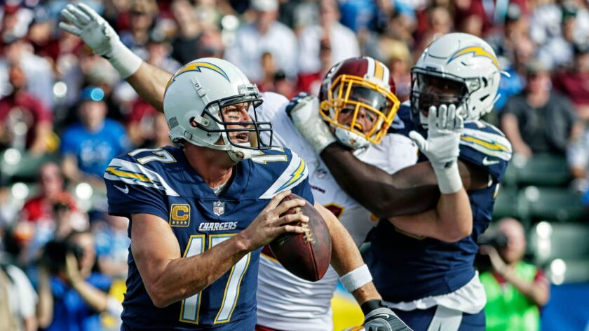 CARSON, CA, SUNDAY, DECEMBER 10, 2017 - Chargers quarterback Philip Rivers scrambles away from press