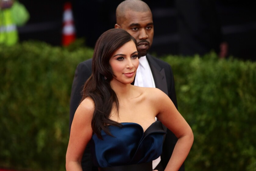 Kim Kardashian and Kanye West attend the Met Gala on May 5 in New York.