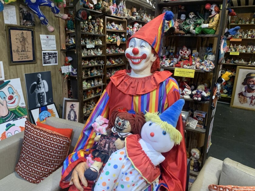 The Clown Hotel lobby, filled with clown toys and figurines