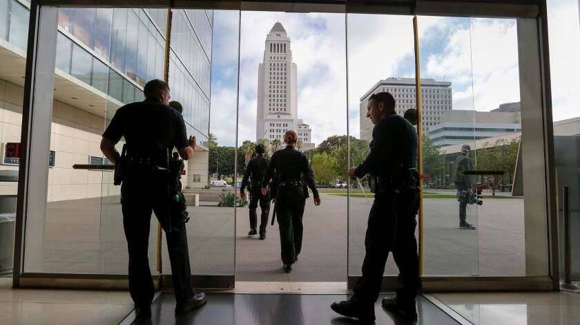 LOS ANGELES, CA., OCTOBER 4, 2016: LAPD officers ramp-up the security around the building prior ro t