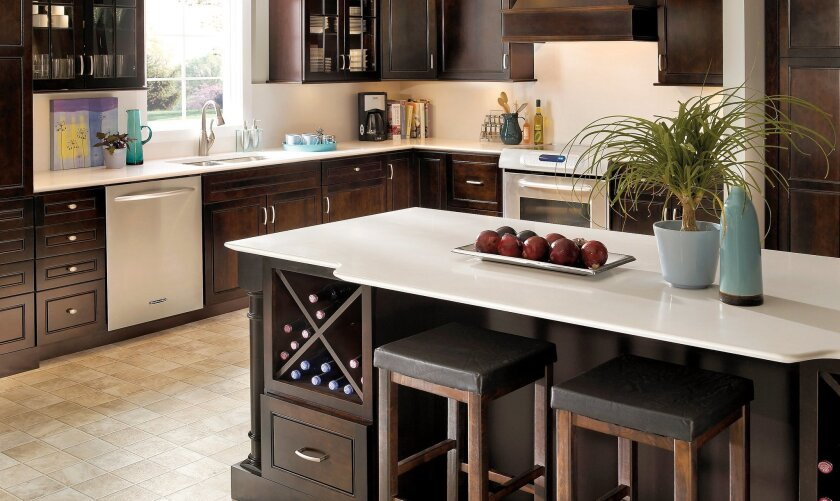 Durable stain-resistant quartz top, guest seating and wine storage contribute to a successful party island.