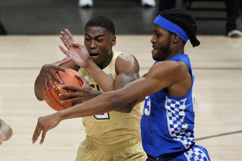 Georgia Tech forward Moses Wright, left, and Kentucky forward Isaiah Jackson, right, battle for control of the ball during the first half of an NCAA college basketball game Sunday, Dec. 6, 2020, in Atlanta. (AP Photo/John Bazemore)