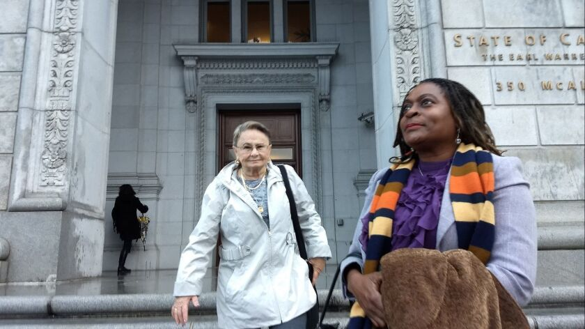 Milena (Sellers) Phillips (right) and Maria Keever on Wednesday as they arrive at the office complex in San Francisco where the California Supreme Court was to hear the appeal of a death sentence for the killer of their sons.
