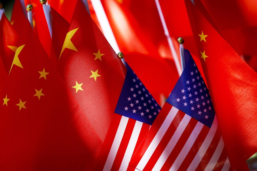 American flags displayed together with Chinese flags