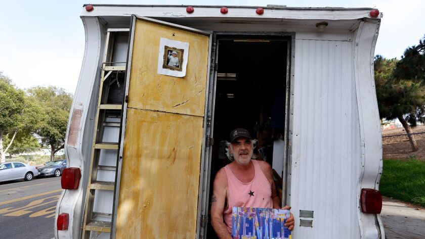 Gary Mann, a sign painter, lives in his camper in Venice. The L.A. City Council has adopted a new overnight ban on occupying and sleeping in cars, vans and campers in residential areas.