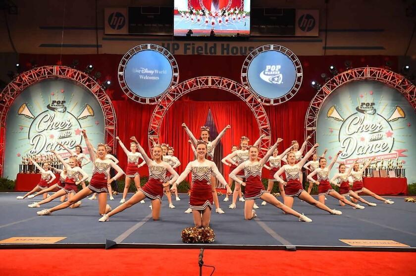 The Torrey Pines Pop Warner JV Cheerleading team on stage.