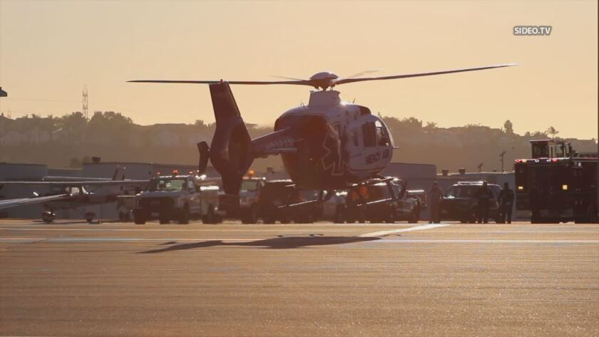 A medical helicopter flies an injured person Tuesday following accident involving scissor lift at McLellan-Palomar Airport.