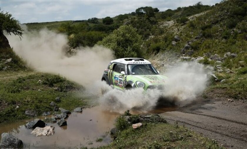 Stephane Peterhansel and Jean Paul Cottret, both of France, race their mini in the 9th stage of the 2013 Dakar Rally from Tucuman to Cordoba, Argentina, Monday, Jan. 14, 2013. The race finishes in Santiago, Chile, on Jan. 20. (AP Photo/Victor R. Caivano)