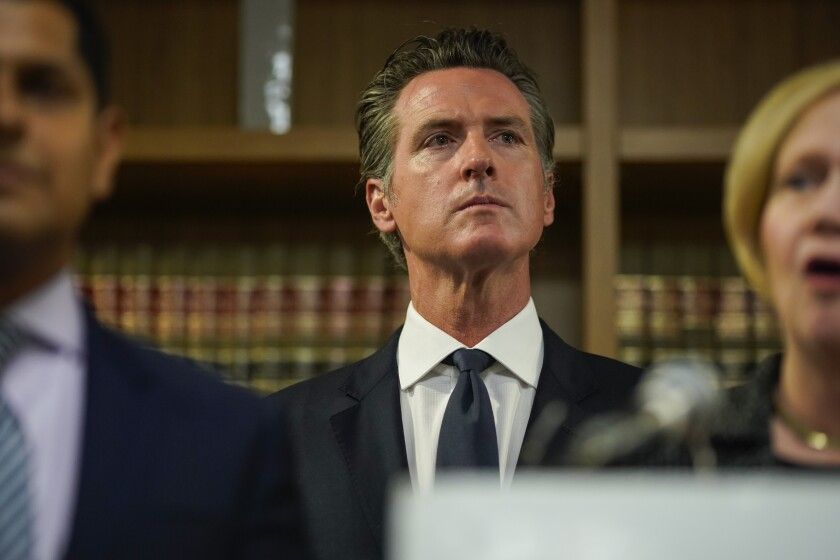 Gov. Gavin Newsom listens during a press conference in Los Angeles on Wednesday.
