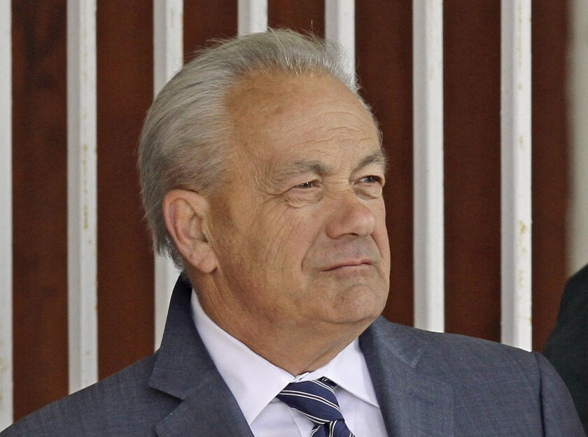 In this March 22, 2014, file photo, horse trainer Jerry Hollendorfer stands in the paddock at Turfway Park in Florence, Ky.