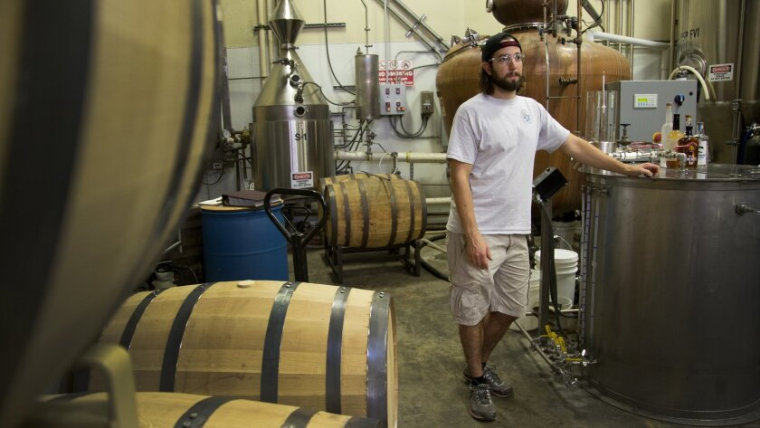 Derek Kermode, lead distiller at Ballast Point, surrounded by the tanks and tools of his trade.
