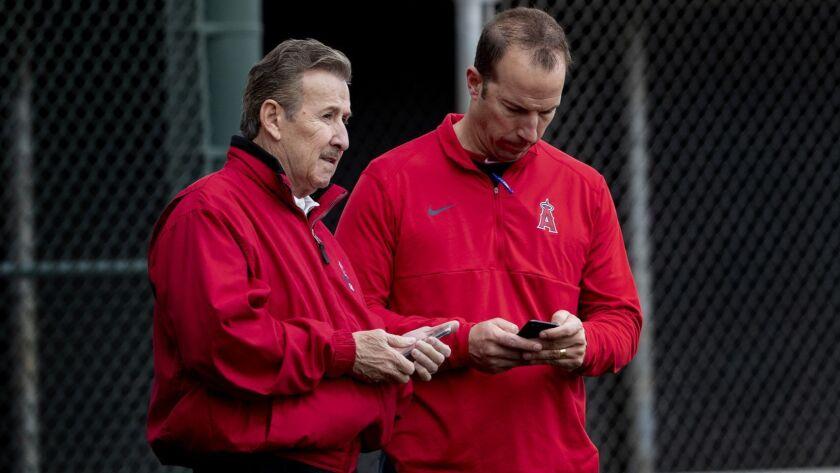TEMPE, AZ - FEBRUARY 18, 2019: Angels owner Arte Moreno, left, and General Manager Billy Eppler che