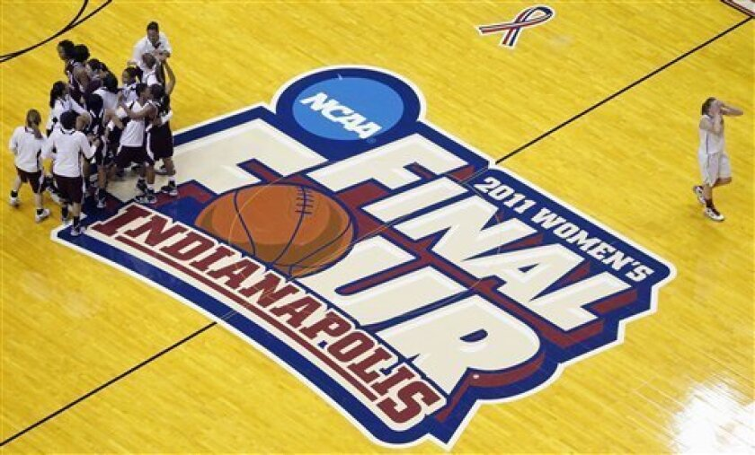 Stanford's Mikaela Ruef (3) walks of the court at right as Texas A&M players celebrate their 63-62 win in a women's NCAA Final Four semifinal college basketball game in Indianapolis, Sunday, April 3, 2011. T(AP Photo/Michael Conroy)