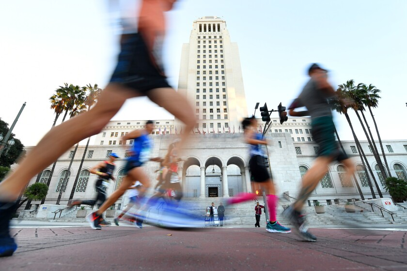 Competitors run past L.A. City Hall during the 2018 L.A. Marathon.