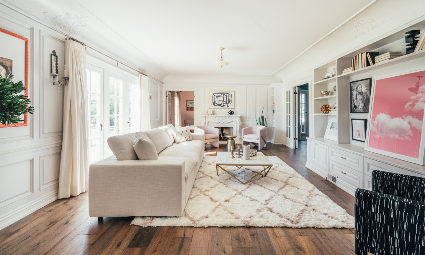 Built in 1923, the elegant abode boasts four bedrooms, four bathrooms and formal living spaces with old-school style across 3,282 square feet.