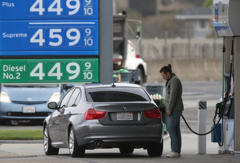 A driver is seen on July 3 pumping gas in Mill Valley, Calif., where prices are well above $4 per gallon.