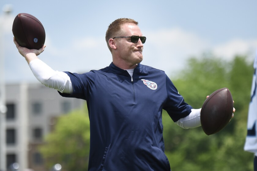 Tennessee Titans offensive coordinator Todd Downing throws to receivers during NFL football training camp Thursday, May 27, 2021, in Nashville, Tenn. (George Walker IV/The Tennessean via AP, Pool)