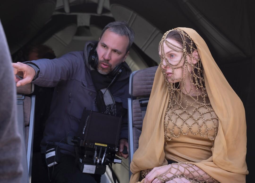 "Director Denis Villeneuve on the set of ""Dune"" with Rebecca Ferguson, who plays Lady Jessica."