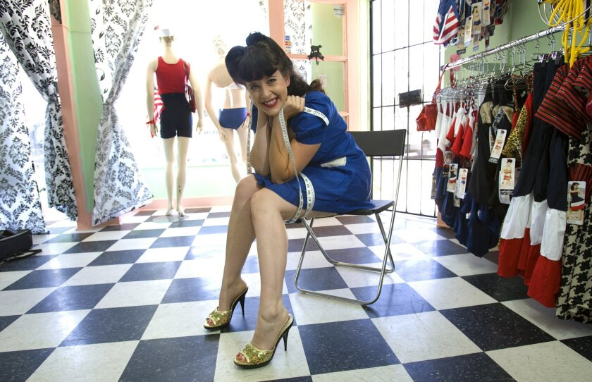 Clothing designer Barrie Kaufman sits among her 2010 swimsuit line at her boutique in Hillcrest.