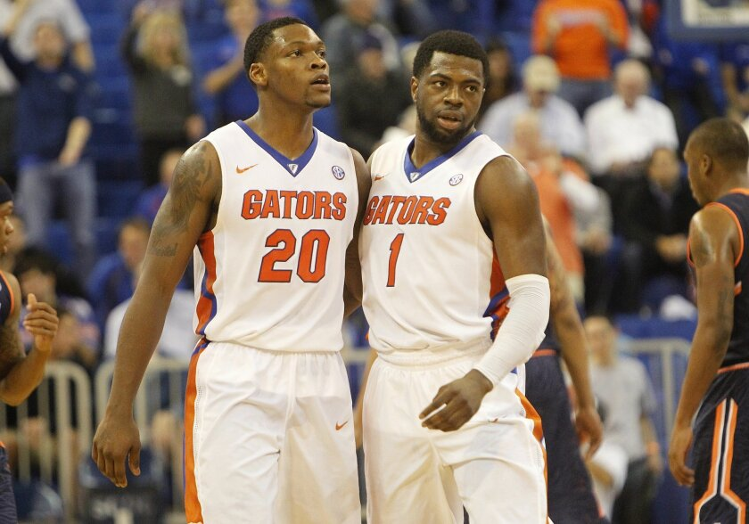 Florida guard Michael Frazier II (20) and guard Eli Carter (1) celebrate after an NCAA college basketball game against Auburn on Thursday, Jan. 15, 2015, in Gainesville, Fla. Florida defeated Auburn 75-55. (AP Photo/The Gainesville Sun, Matt Stamey) THE INDEPENDENT FLORIDA ALLIGATOR OUT