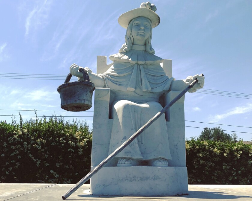 A statue of the Santo Niño de Atocha at Holy Sepulcher Cemetery in Orange.
