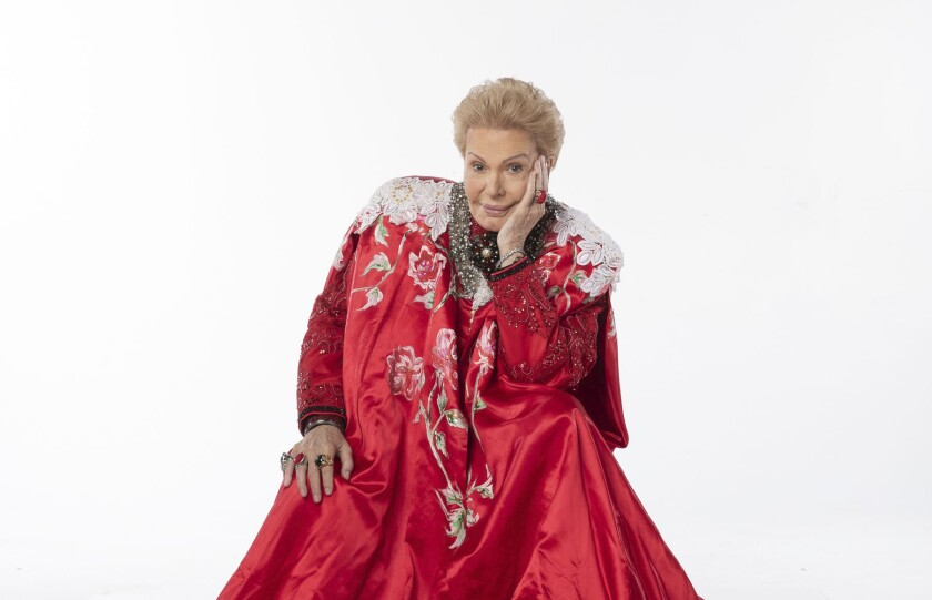 "Walter Mercado in a red cape in the documentary ""Mucho Mucho Amor."""