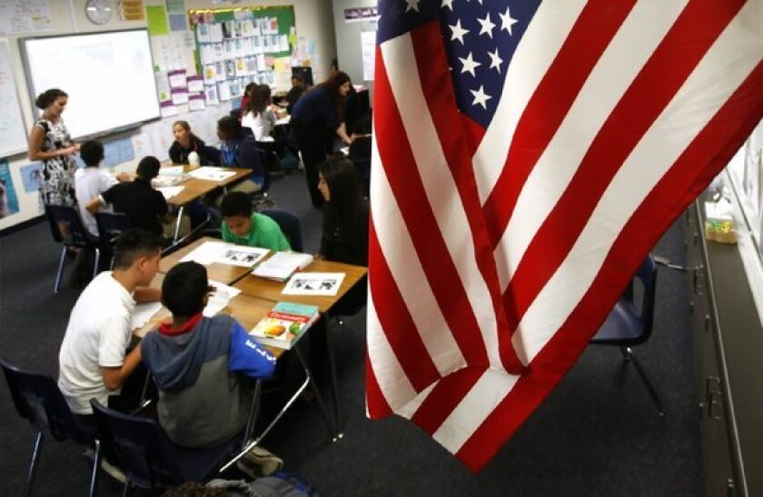 In an effort to emphasize critical thinking and prepare students for more complex tests, the Santa Ana Unified School District is using the Common Core learning standards in this seventh-grade class at Santiago Elementary School.