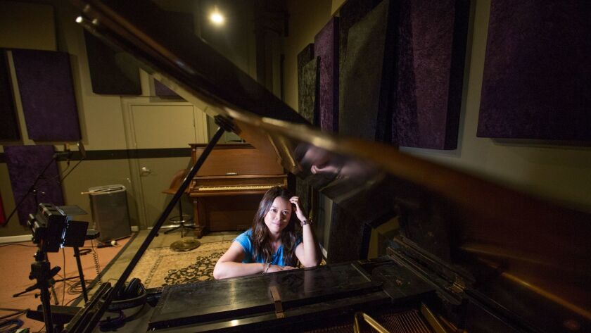 TUSTIN, CALIF. -- TUESDAY, AUG. 29, 2017: Giana Nguyen, singer, songwriter and piano teacher from