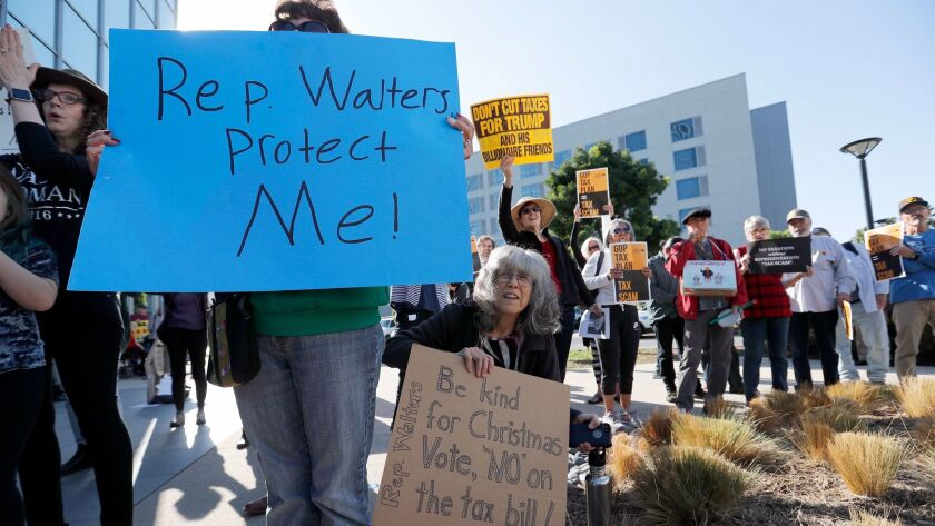 IRVINE, CALIF. -- TUESDAY, DECEMBER 19, 2017: Activists rally outside of Rep. Mimi Walters' Irvine