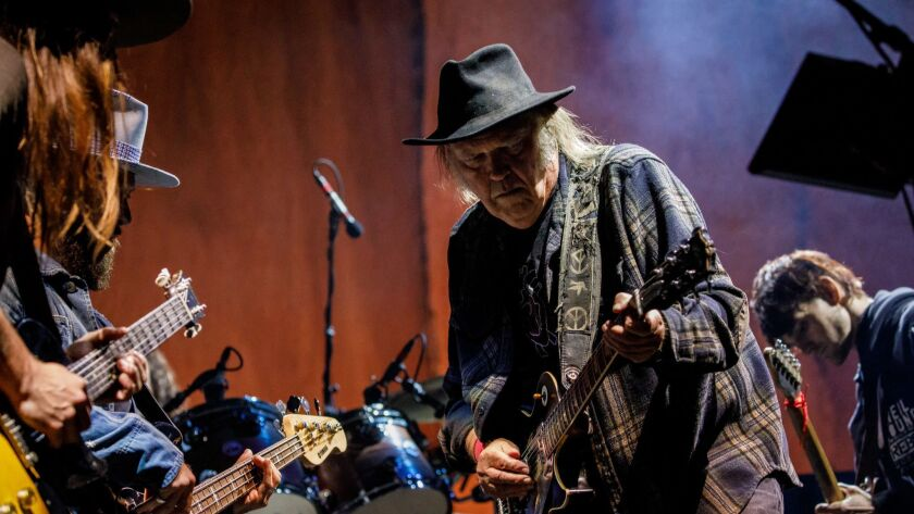 PASADENA, CALIF. -- SATURDAY, JUNE 23, 2018: Neil Young and members of Promise of the Real perform a