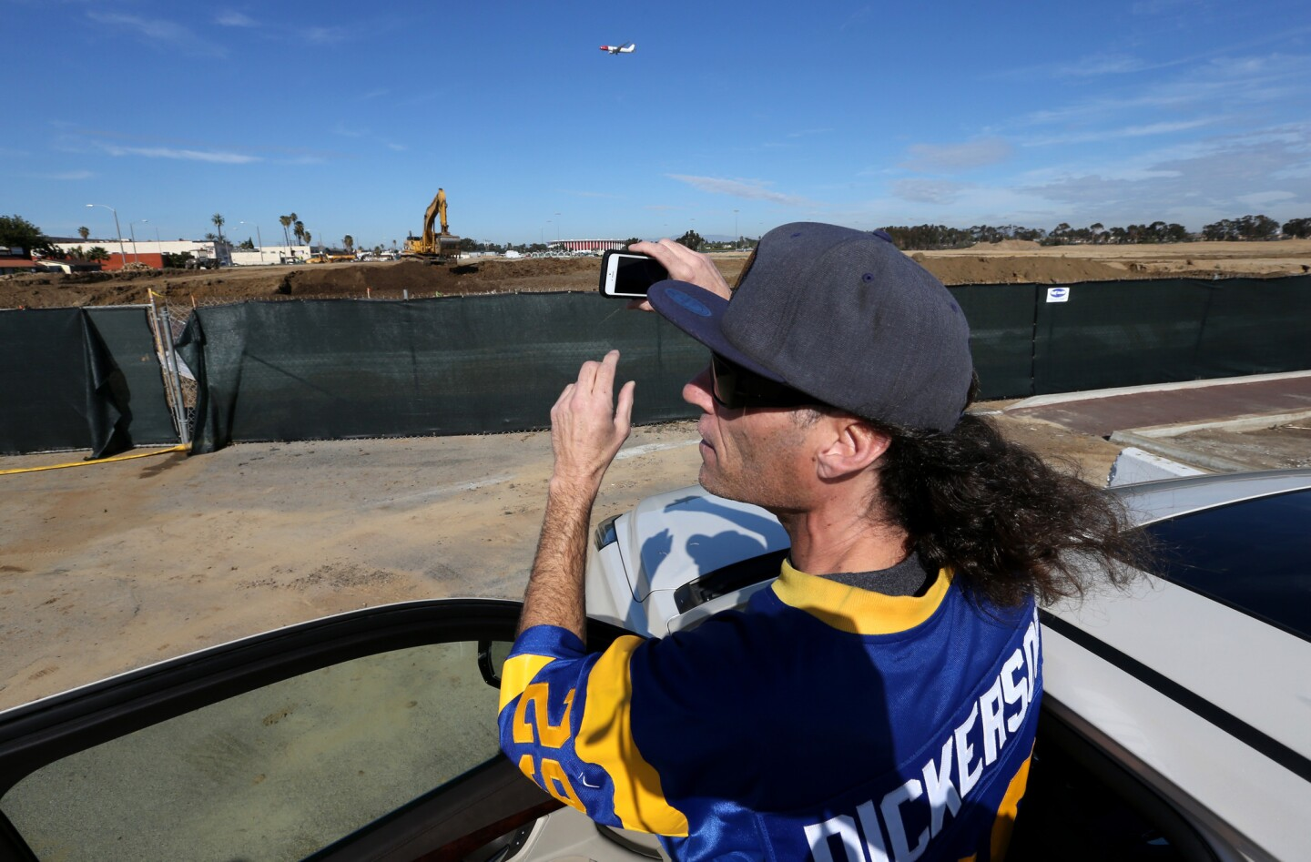 Longtime Rams football fan Dave Frazier, 50, visits the site of a new NFL stadium under construction near the Forum in Inglewood.