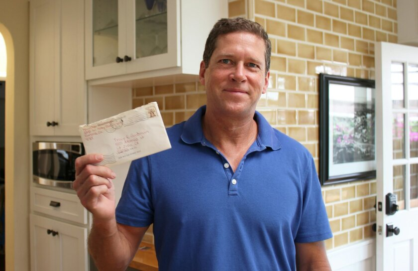 Bruce Craig holds a letter addressed to a woman who lived at his La Jolla address nearly four decades ago. It was delivered in early July, almost 38 years after its September, 1977 postmark.