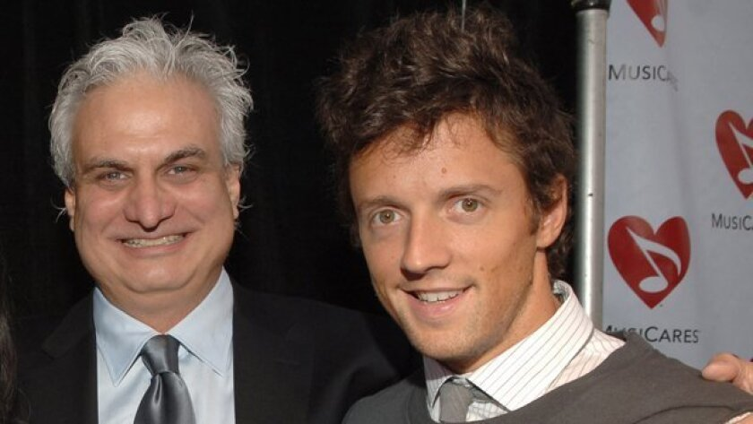 Former San Diego concert Bill Silva (left) and Jason Mraz, who he manages. Silva and his business partner, Andrew Hewitt, have just signed a deal to work with Live Nation, the world's largest concert and live events promoter. Photo courtesy of The Recording Academy.