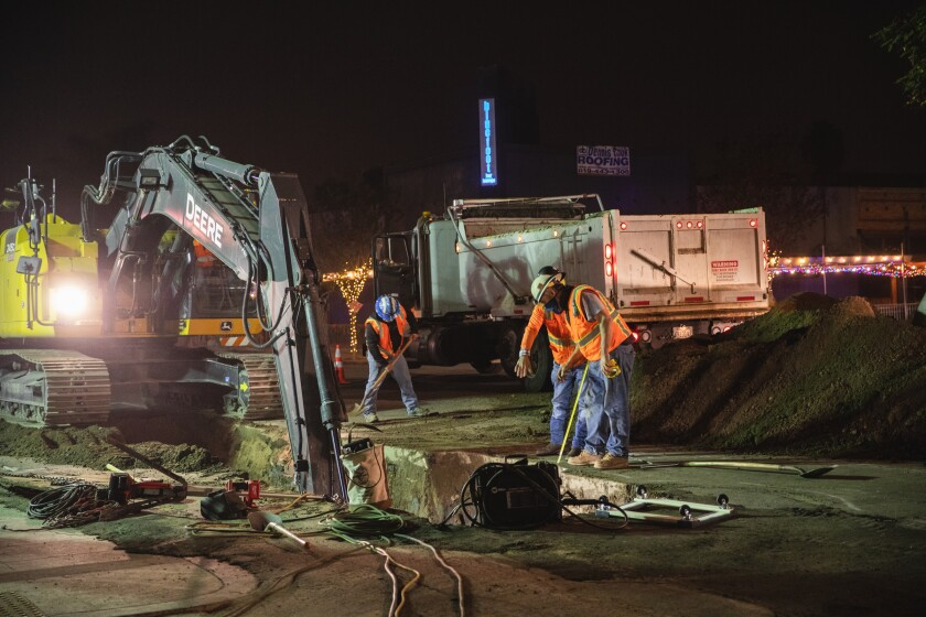 Construction workers on 30th Street in North Park have been working at nighttime to avoid impacting local businesses.