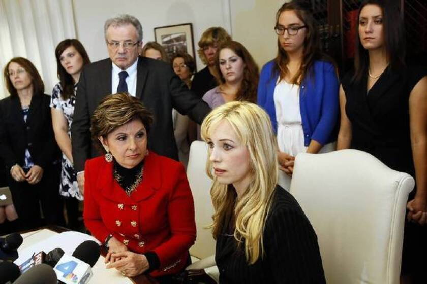 Attorney Gloria Allred, left, and Caroline Heldman, professor of politics, along with sexual assault victims at a news conference last April to announce the filing of a complaint against Occidental.