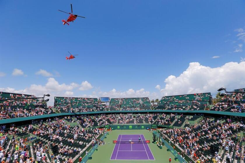 US Coast Guard MH-65 helicopters fly over the Crandon Tennis Center stadium court before Alexander Zverev of Germany faces John Isner of the US during the men's singles final round match at the Miami Open tennis tournament on Key Biscayne, Miami. EFE